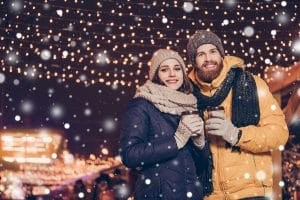 couple in the snow at The Bentleyville Tour of Lights