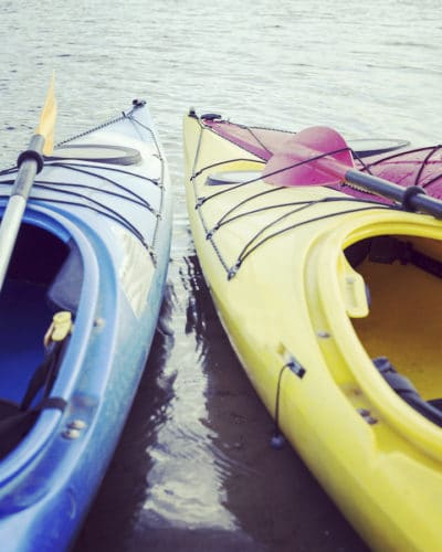 blue and yellow kayaks on tour with mom