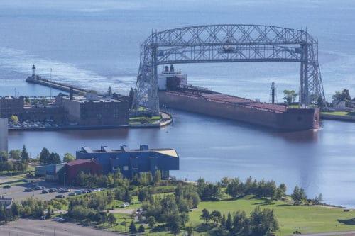 A ship entering a harbor on Lake Superior.