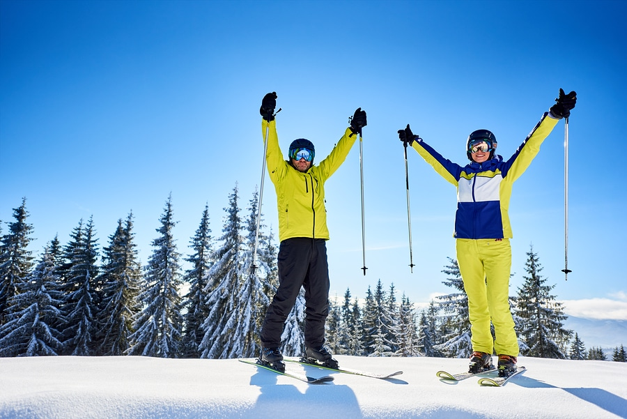 Smiling Couple Of Skiers on Mountain top on Spirit Mountain Duluth