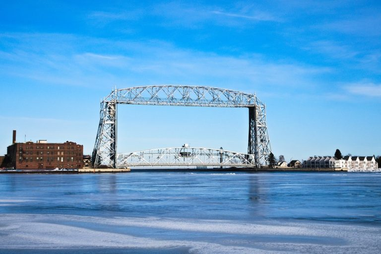 Aerial lift bridge on sunny day Canal Park Duluth